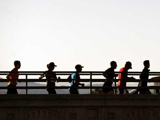 "Participants of a locally organized ""Run For Boston"" run along Bouquet Canyon Road in Saugus on Thursday. Signal photo by Jonathan Pobre"