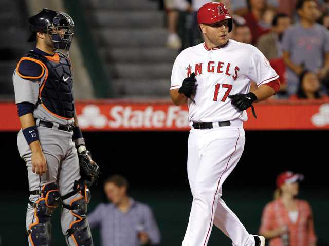 Los Angeles Angels' Chris Iannetta (17) scores on a base hit by teammate Brendan Harris (not pictured) in front of Detroit Tigers catcher Alex Avila, left, in the fourth inning during a baseball game Friday, April 19, 2013, in Anaheim.