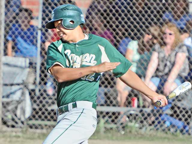 Canyon's Taro Okada knocks in the game-winning run in the seventh inning at Hart High on Friday.