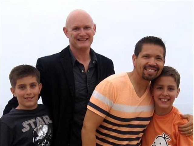 Kevin Covey, center left, and his husband, Joseph, stand with their sons Austin, left, and Dakota at Newport Beach, Calif. on Saturday, April 13, 2013.