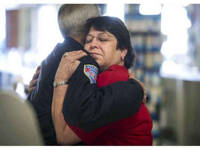 West resident Jeanette Sulak embraces West Police Chief James Lawhorn at West Drug, the downtown drug store owned by her and her husband Mike, on Friday in West, Texas.