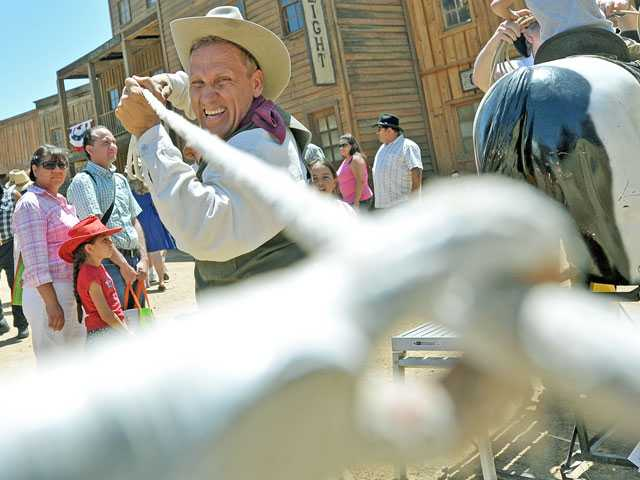 Trick roper Will Roberts shows off his skill at the 20th annual Santa Clarita Cowboy Festival on Saturday at Melody Ranch Motion Picture Studio in Santa Clarita.