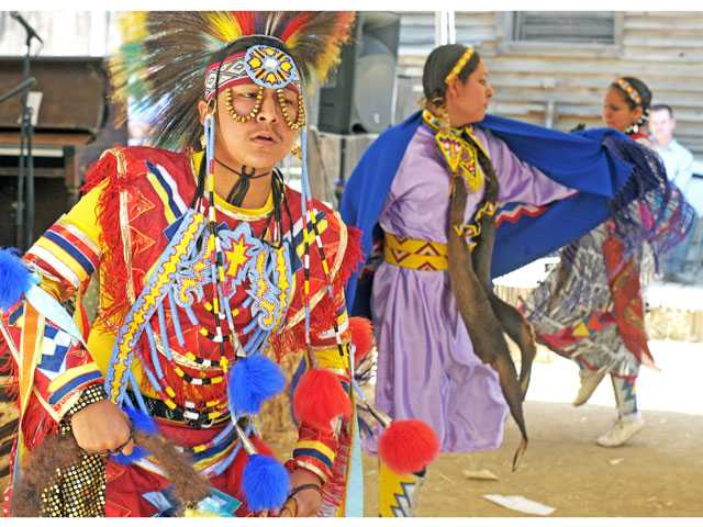 """The Wildhorse Dancers,"" from left, Shiigo, Shandiin and Starr Yellowhorse perform an intertribal dance on the Medicine Show Stage at the Santa Clarita Cowboy Festival on Saturday. The festival continues today."