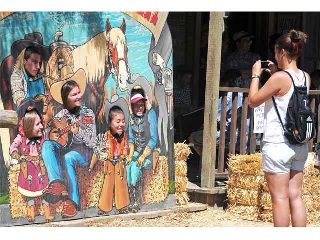 Devon Goff, right, takes a photo of (counterclockwise from top left) Kenny Gardner, Mackenzie Taylor, Gabriellea Arnone, Jessica Long and Ashley Hopkins on Main Street at Melody Ranch.