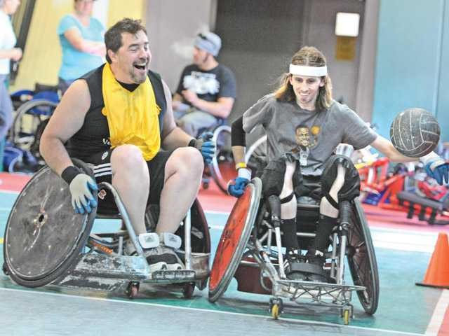 Dave Nicholls, left, crashes into Joey Mearig's wheelchair during a rugby game at the wheelchair sports event held at the City of Santa Clarita Sports Complex in Santa Clarita.  Nicholls drove from Park City Utah to attend the event on Saturday. Photo by Dan Watson.