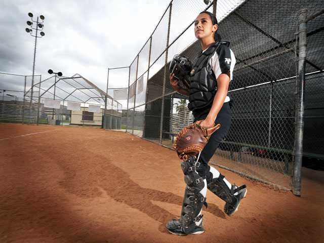 Canyon junior catcher Julianna Carlos was brought up to varsity as a freshman, but sat on the bench behind former All League catcher Courtney Ziese. Carlos made the most of her time in the dugout, watching and waiting — now it's her time to shine.