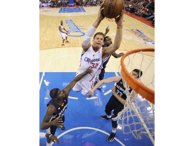 Los Angeles Clippers forward Blake Griffin, second from left, goes up for a shot  Los Angeles on Saturday.