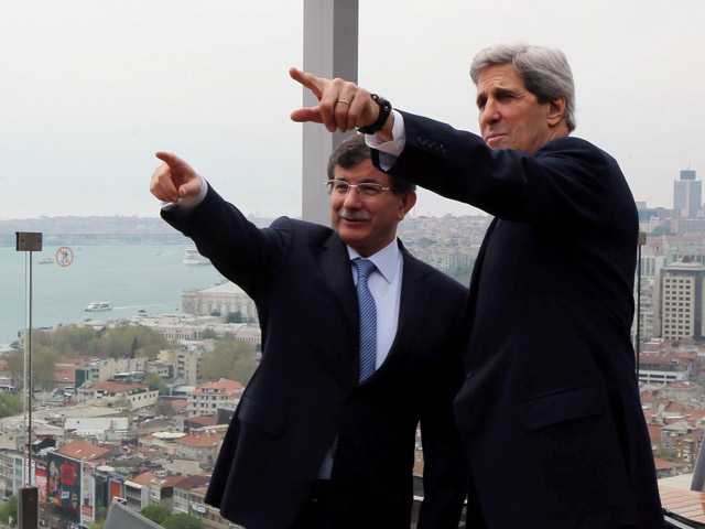 U.S. Secretary of State John Kerry, right, and his Turkish counterpart Ahmet Davutoglu point toward the Bosporus before a working lunch in Istanbul, Turkey on Sunday.