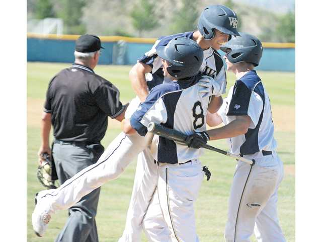 West Ranch's J.D. Krauskopf is lifted by teammate Justin Hovis after hitting a three-run home run in a CIF-SS Division I playoff game on May 18, 2012. Krauskopf has committed to Sonoma State.