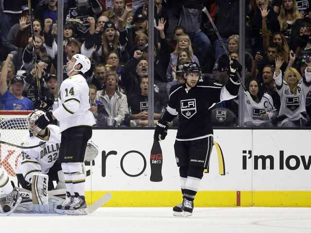 Los Angeles Kings' Mike Richards (10) celebrates his goal as Dallas Stars goalie Kari Lehtonen (32) and Jamie Benn(14) look on in Los Angeles, Sunday.