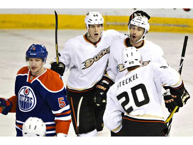 Anaheim Ducks Bryan Allen (55), Radek Dvorak (18) and David Steckel (20) celebrate a goal as Edmonton Oilers Ladislav Smid (5) skates by in Edmonton on Monday.