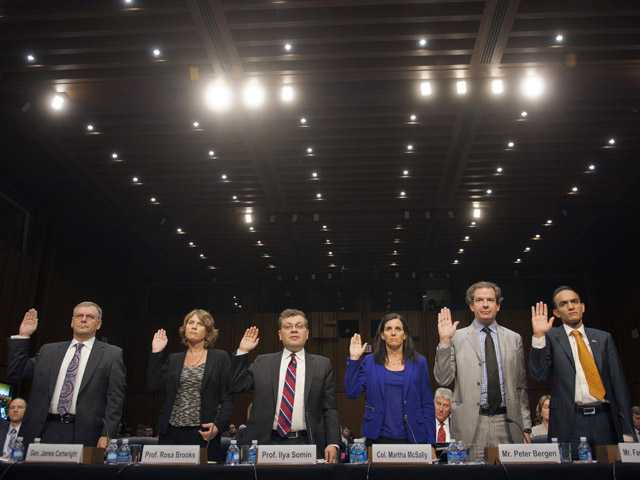 Witnesses are sworn-in before testifying on Capitol Hill in Washington on Tuesday at a hearing on drones.