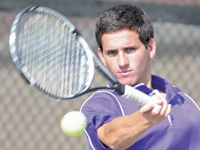 Joey Fernicola of Valencia tennis returns a shot against Hart at Valencia on Tuesday. Valencia won 16-2.