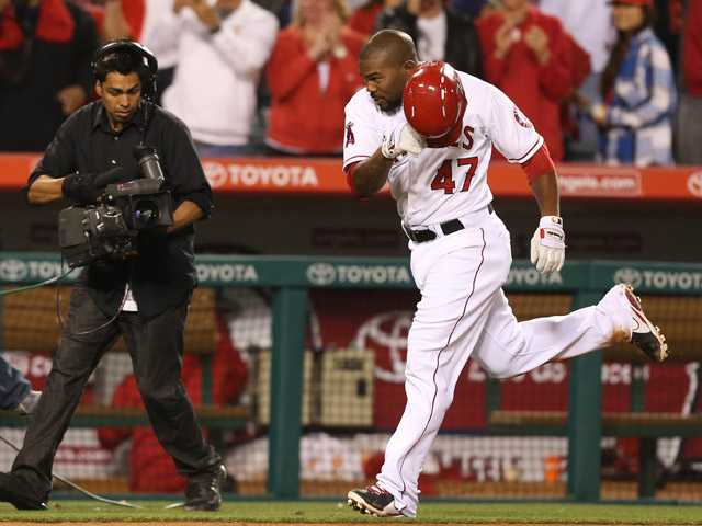 Los Angeles Angels Howie Kendrick begins to celebrate after a solo home run to beat the Texas Rangers 5-4 in the eleventh inning in Anaheim on Tuesday.