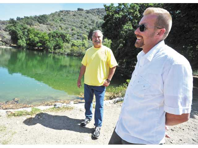 Steve Arklin, left, and Derek Hunt converse near a manmade lake at Hunt's Rancho Maria & Sable Ranch.