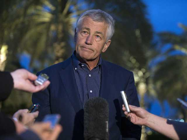 U.S. Secretary of Defense Chuck Hagel speaks with reporters after reading a statement on chemical weapon use in Syria during a press conference in Abu Dhabi, United Arab Emirates on Thursday.