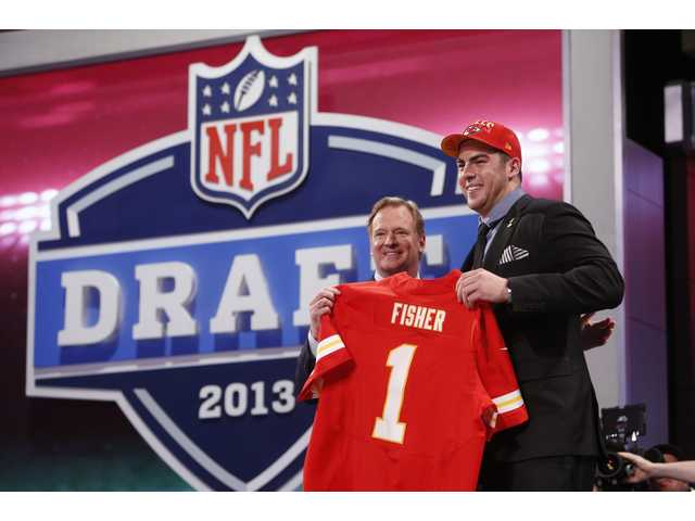 Eric Fisher, from Central Michigan, stands with NFL Commissioner Roger Goodell after being selected first overall by the Kansas City Chiefs in the first round of the NFL draft on Thursday in New York.