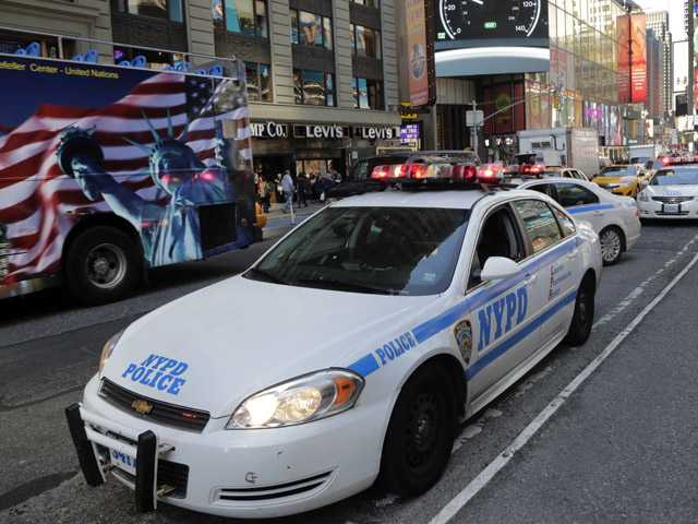 New York City Police officers patrol in New York's Times Square on Thursday. The Boston Marathon bombing suspects had planned to blow up their remaining explosives in New York's Times Square, officials said Thursday.