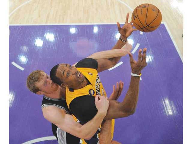 Los Angeles Lakers center Dwight Howard, right, rises for a shot on Friday in Los Angeles.