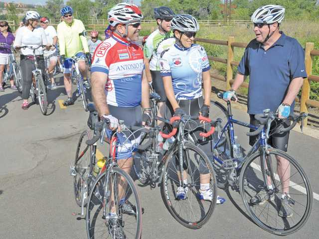 Cyclists Bob DiPimio, left, and Irene Johnson, center, of Santa Clarita Velo, join city of Santa Clarita Mayor Bob Kellar at the start of the Mayor's Ride event held at Iron Horse Trailhead in Valencia on Saturday. The 6-mile ride included roughly 20 people.