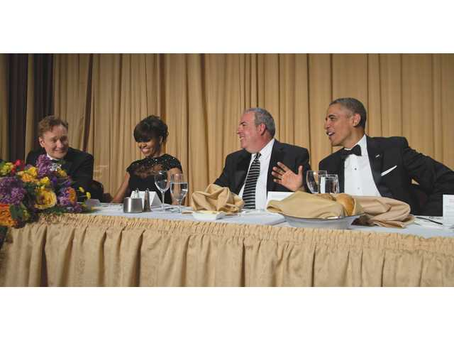From left, late-night television host Conan O'Brien, first lady Michelle Obama, Michael Clemente, executive vice president of Fox News and President Barack Obama attend the White House Correspondents' Association Dinner on Saturday in Washington.