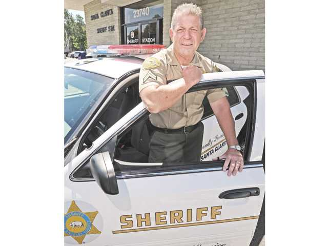 Artie Thompson with a sheriff's patrol car.