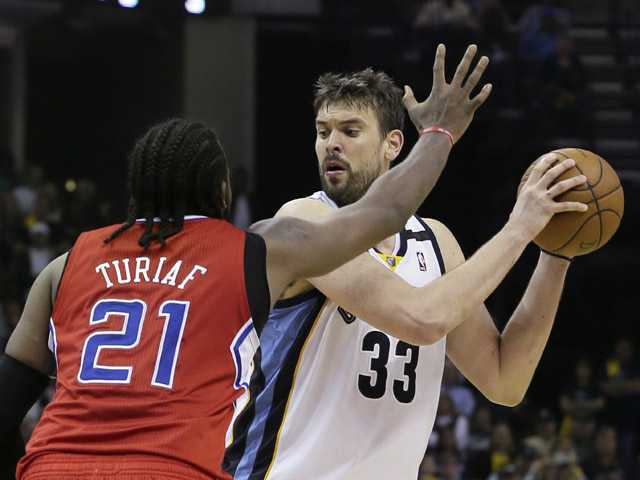 Memphis Grizzlies' Marc Gasol (33) is pressured by Los Angeles Clippers' Ronny Turiaf (21) during the second half of Game 4 in a first-round NBA basketball playoff series in Memphis, Tenn., on Saturday.