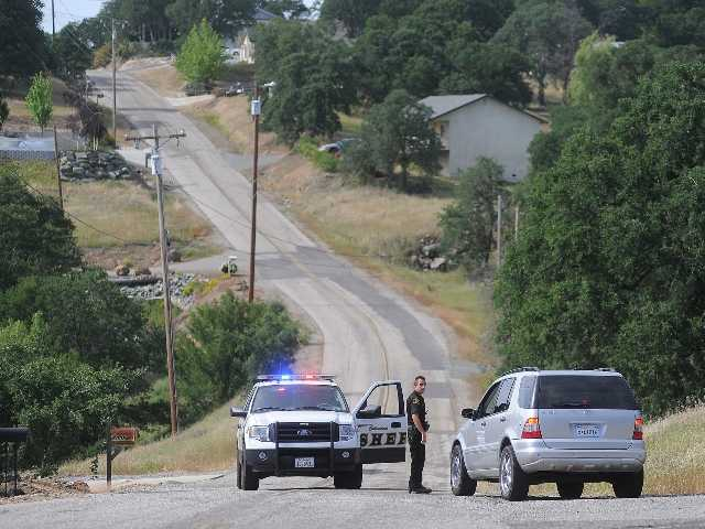 A Calaveras County Sheriff's deputy detains a driver where 8-year-old Leila Fowler was found murdered Saturday evening.