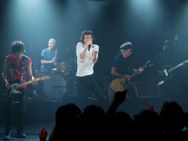 "This April 27 photo provided by The Rolling Stones shows the group performing during a surprise gig at the Echoplex in Los Angeles. The legendary group rocked a small club in Los Angeles on Saturday night for a minuscule crowd compared to the thousands set to see them launch their ""50 and Counting"" anniversary tour a week later on May 3 at the Staples Center."