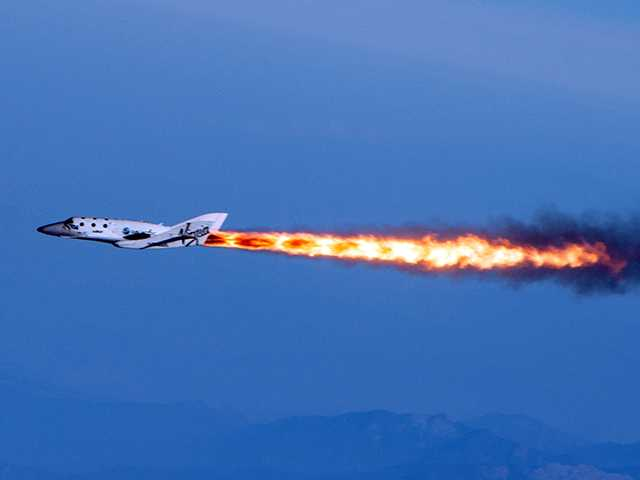 "This photo provided by Virgin Galactic shows Virgin Galactic's SpaceShipTwo under rocket power, its first ever since the program began in 2005. The spacecraft was dropped from its ""mothership,"" WhiteKnightTwo, over Mojave, Calif. on Monday."
