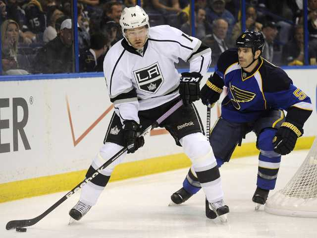 Los Angeles Kings' Justin Williams (14) looks to pass in front of St. Louis Blues' Barret Jackman (5) on Tuesday in St. Louis.