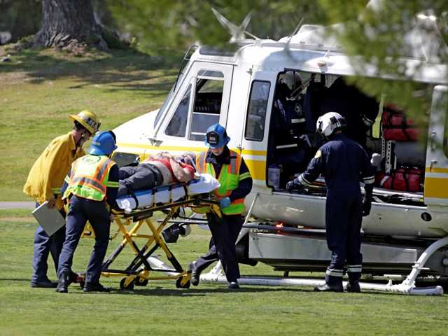 A victim is transported to a rescue helicopter after a plane made an emergency landing Monday. A second body was found Tuesday at a rugged site in the Santa Monica Mountains.