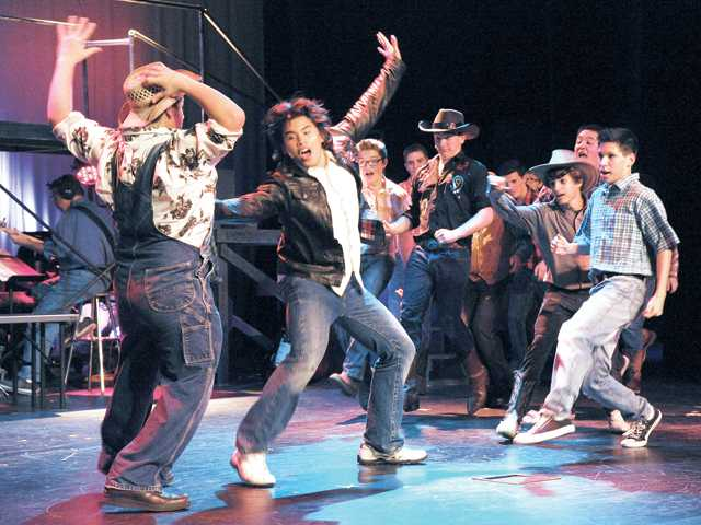"Matt San Jose, center, as Ren McCormack dances during the number ""Let's Hear It For The Boy"" during the dress rehearsal of ""Footloose"" at Golden Valley High School on Monday."