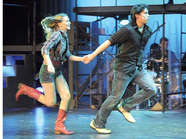 "Tori Bohush as Ariel, left, and Matt San Jose as Ren run off to dance during the dress rehearsal of ""Footloose"" at Golden Valley High School on Monday."