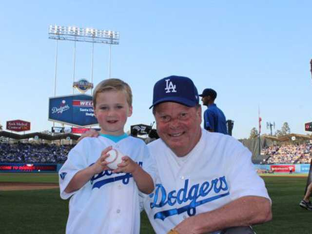Josh Murphy, 4, served as the ball boy and Mayor Bob Kellar threw out the ceremonial first pitch on April 27 during SCV Dodger Day events at Dodger Stadium in Los Angeles.