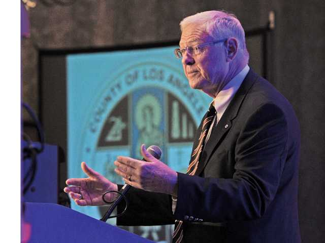 "Supervisor Michael Antonovich addresses several hundred during his annual ""State of the County"" presentation at the Hyatt Regency Valencia on Wednesday. Signal photo by Dan Watson"