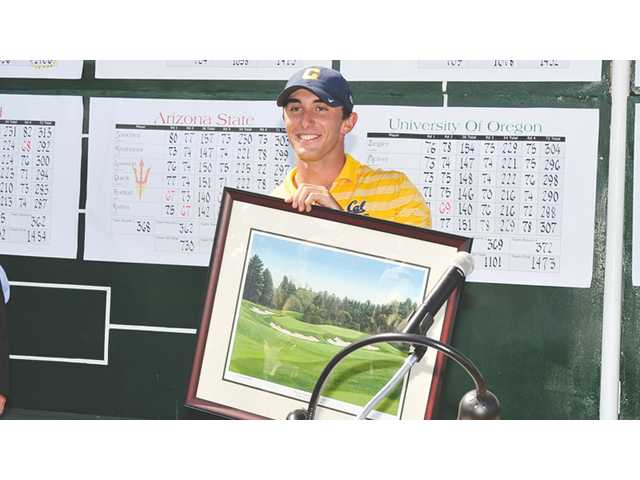 University of California, Berkeley senior Max Homa, a Valencia High graduate, poses with a plaque after winning the individual Pac-12 Championship on Wednesday in Los Angeles.