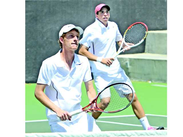 The Valencia doubles team of Cameron Braun, left, and Chris Pope participated in the Foothill League prelims at The Paseo Club on Wednesday.