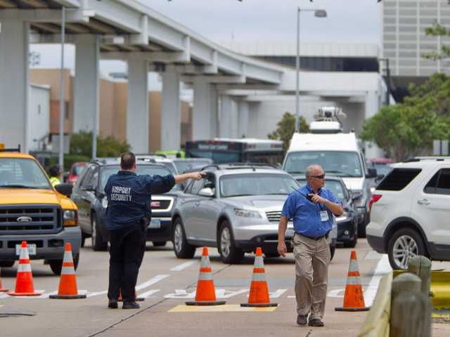 A man who had fired a gun inside a ticketing area at Houston's largest airport was killed by police.