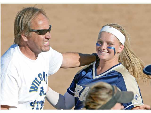 West Ranch head coach Bob Shults celebrates his team's win over Saugus with pitcher Lexi Sorenson on Thursday.