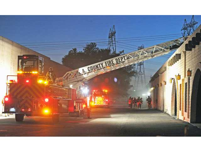 Firefighters work a structure fire at 26841 Ruether Ave. in Canyon Country on Thursday evening. Photo by Jonathan Pobre.