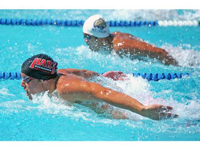 Hart's Griffin Scott prepares to dive into the water in the boys 100-yard butterfly on Thursday at the Santa Clarita Aquatics Center.