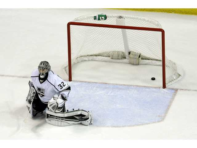 Los Angeles Kings goalie Jonathan Quick is slow to get up after allowing a goal by St. Louis Blues' Barret Jackman on Thursday in St. Louis.