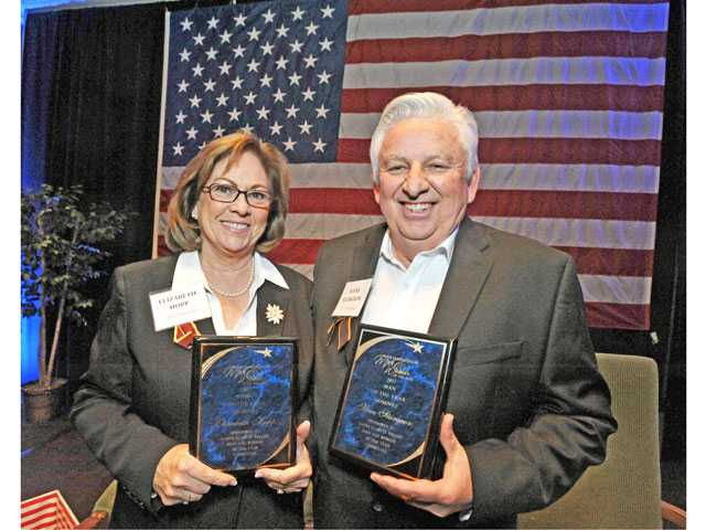 Elizabeth Hopp, left and Steve Sturgeon are named the Santa Clarita Valley Woman of the Year and Man of the Year, at the Hyatt Regency Valencia on Friday.