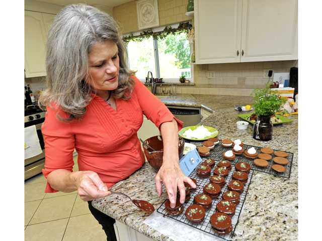 Merry Graham puts the finishing touches on her Margarita Moon Pies in her Newhall kitchen.