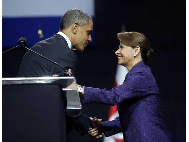 President Barack Obama, left, and Costa Rica President Laura Chinchilla, right, shake hands at the end of a news conference at the National Center for Art and Culture in San Jose, Costa Rica on Friday.