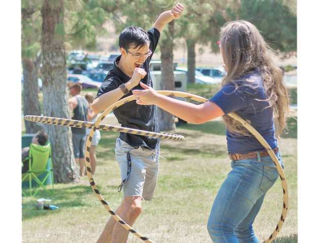Sean Fitzpatrick, left, and Cari Steves, Hula hoop during Castaic Days Outdoor Festival on Saturday at Castaic Lake.