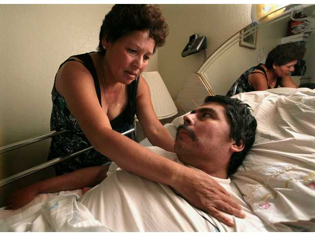 In this Oct. 13, 2008 photo, Lucila Huerta, tends to her husband Guadalupe, who is suffering from Valley Fever and other medical problems, in their apartment in Madera, Calif. Valley Fever, a little-known disease infecting more people nationwide every year, is especially prevalent in California's San Joaquin Valley.