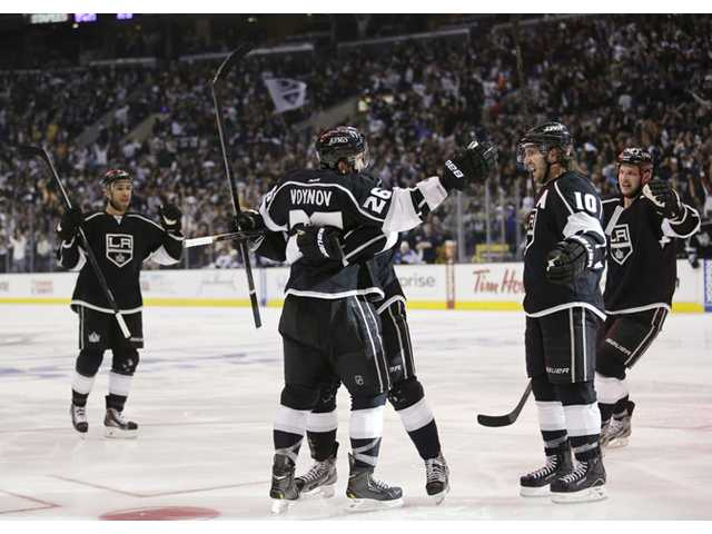 Los Angeles Kings' Slava Voynov (26) celebrates his goal with teammates during the second period in Game 3 of a first-round Stanley Cup playoff series against the St. Louis Blues in Los Angeles on Saturday.