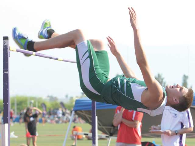 Canyon's Brett Molster competes in the high jump on Friday at Valencia High during the Foothill League finals. Molster won the event.